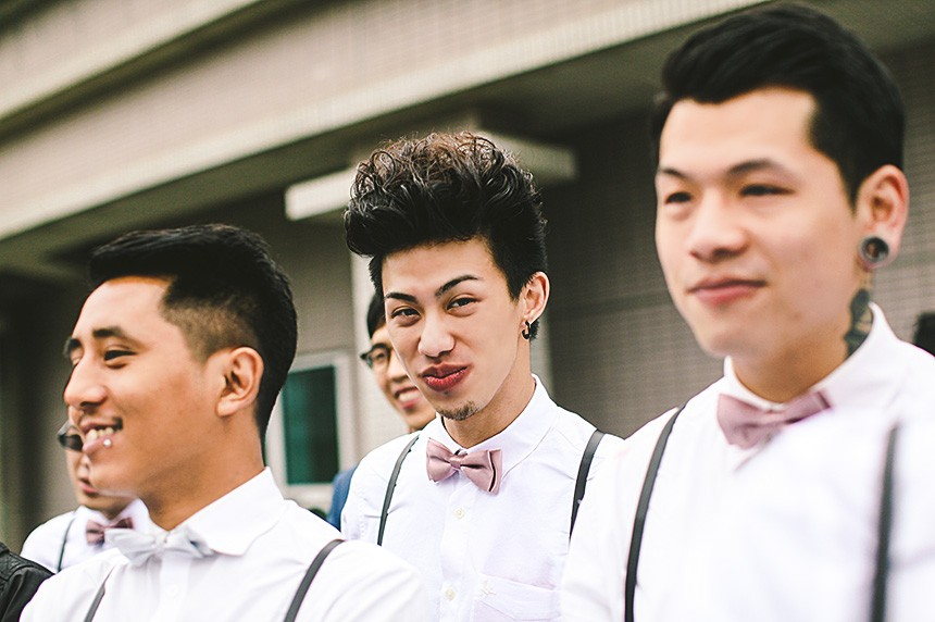 groomsmen waiting at a wedding for bride